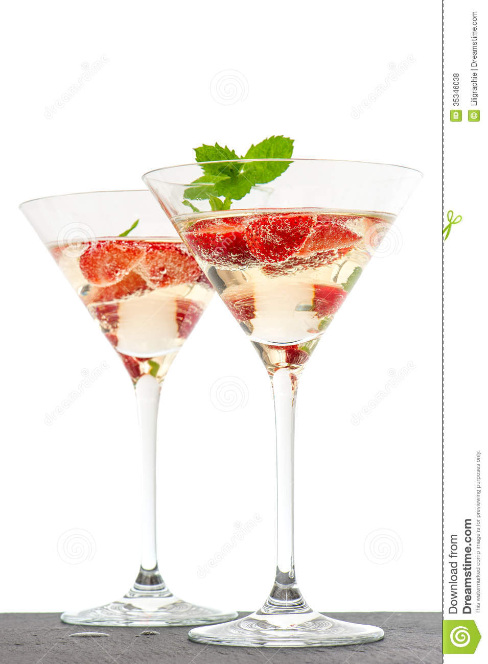 strawberry cocktail with berry in martini glass isolated on whit royalty free stock photos