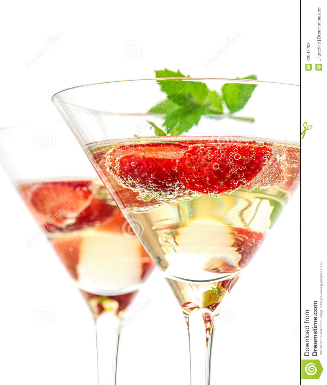 Strawberry cocktail with berry in martini glass stock for White wine based cocktails
