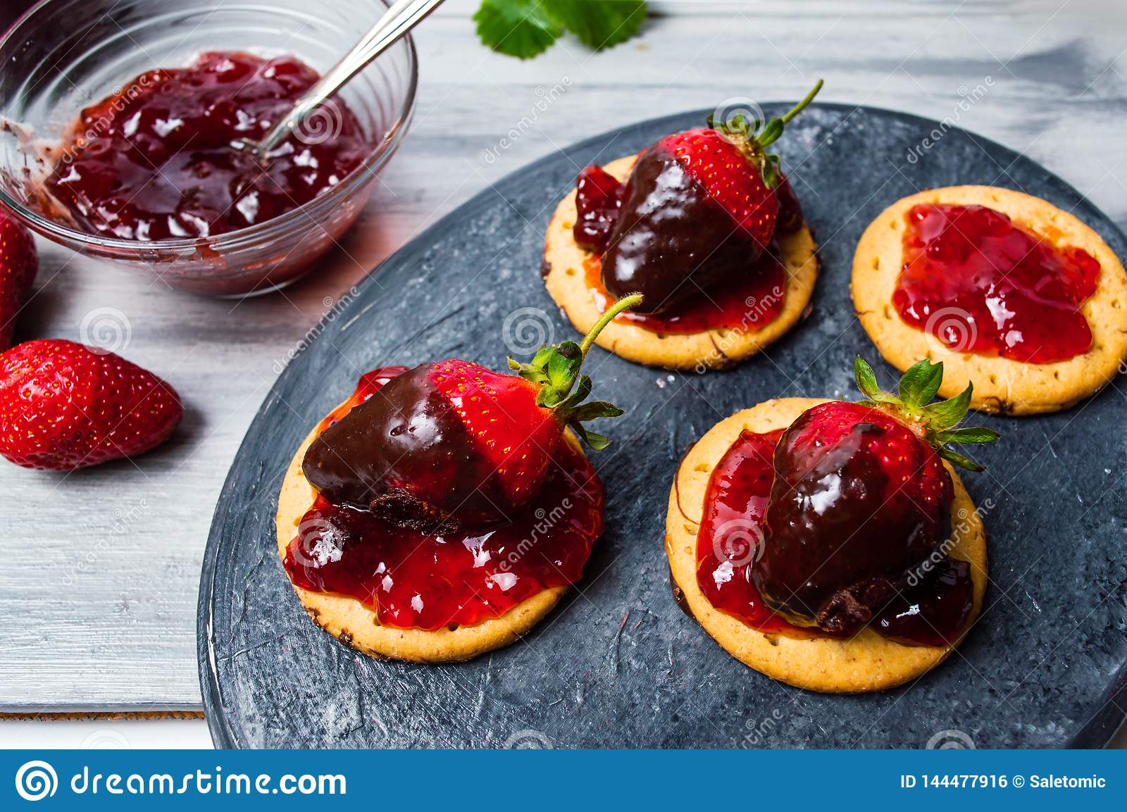Strawberry dessert on a biscuit with jam