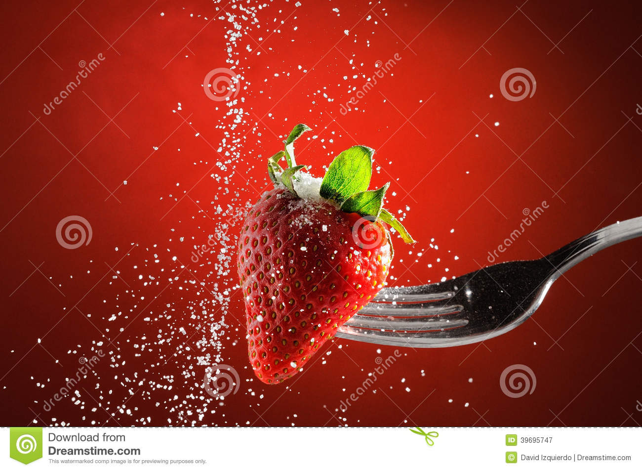 Strawberry on a fork punctured falling sugar detail