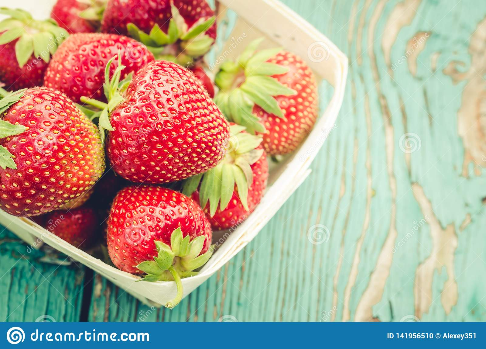 Strawberry. fresh berries of strawberry/Top view. Strawberry in small basket on natural wooden background