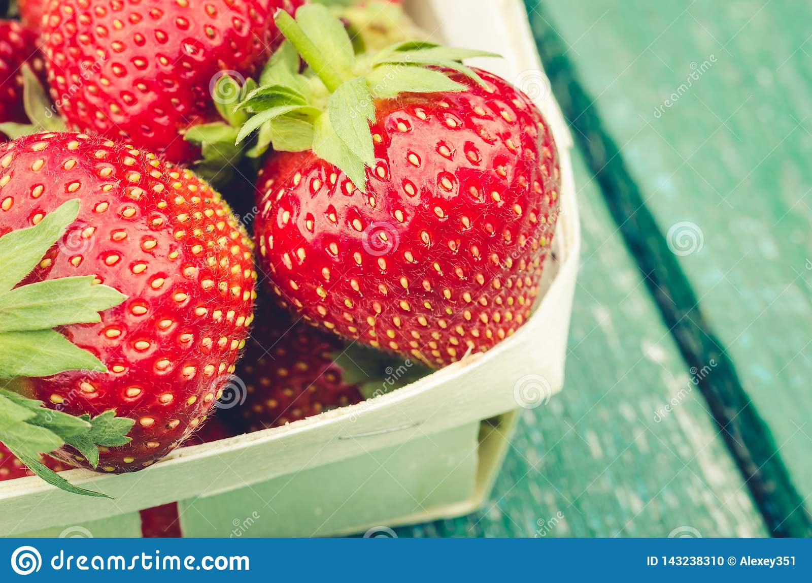 Strawberry. fresh berries of strawberry/fresh berries of strawberry on wooden background closeup. Top view