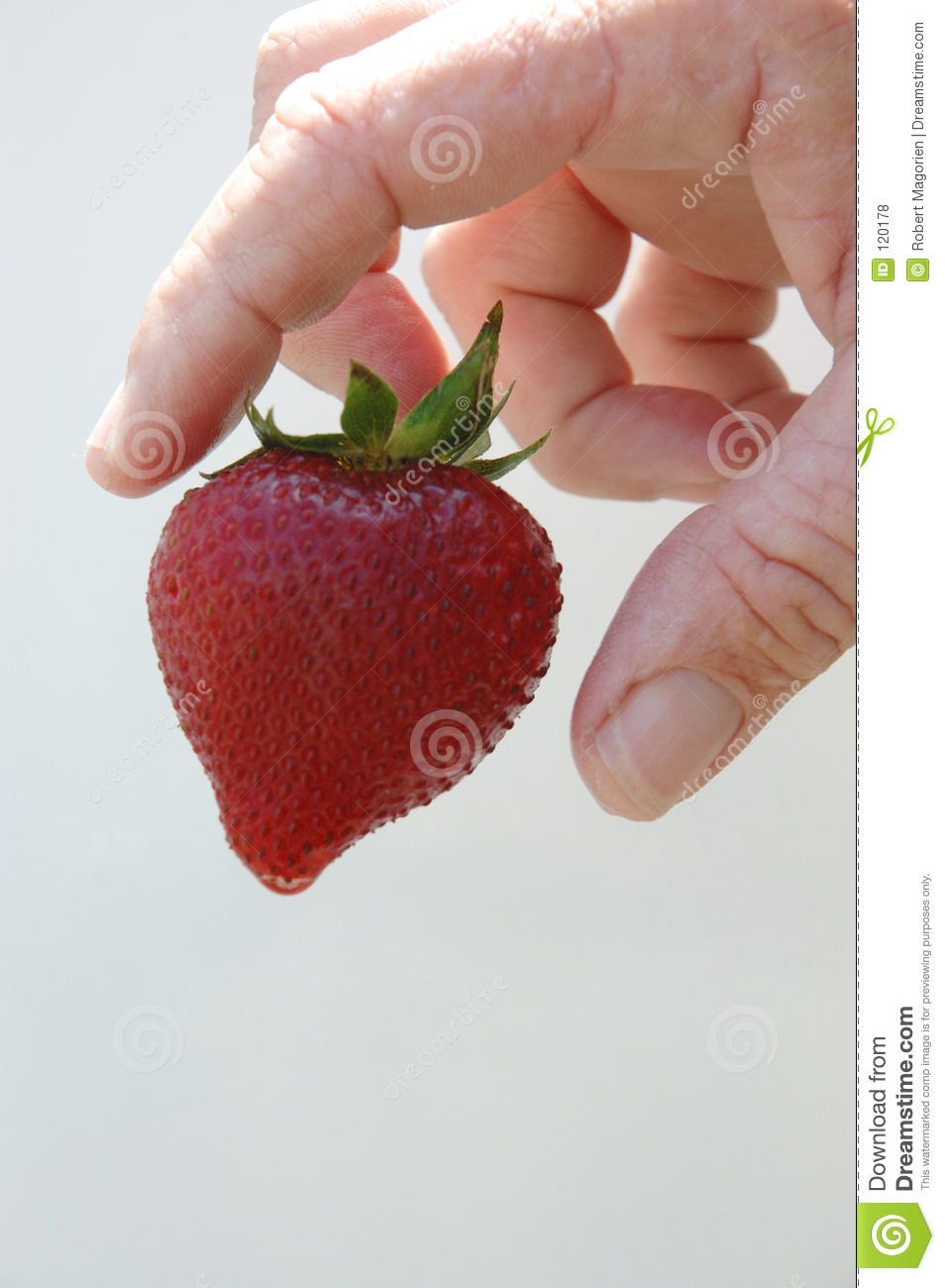 Strawberry and hand