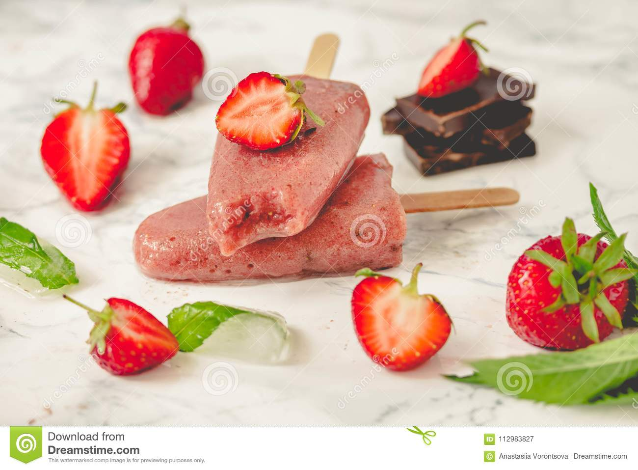 Strawberry ice cream with a banana and chocolate on a stick. Sum