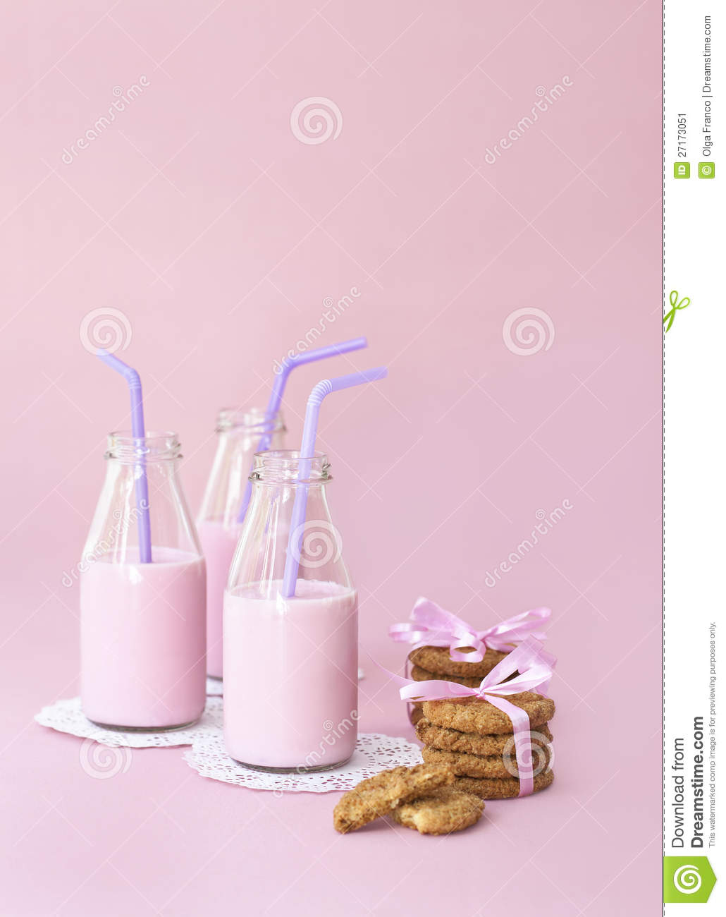 Strawberry milk and cookies on pink