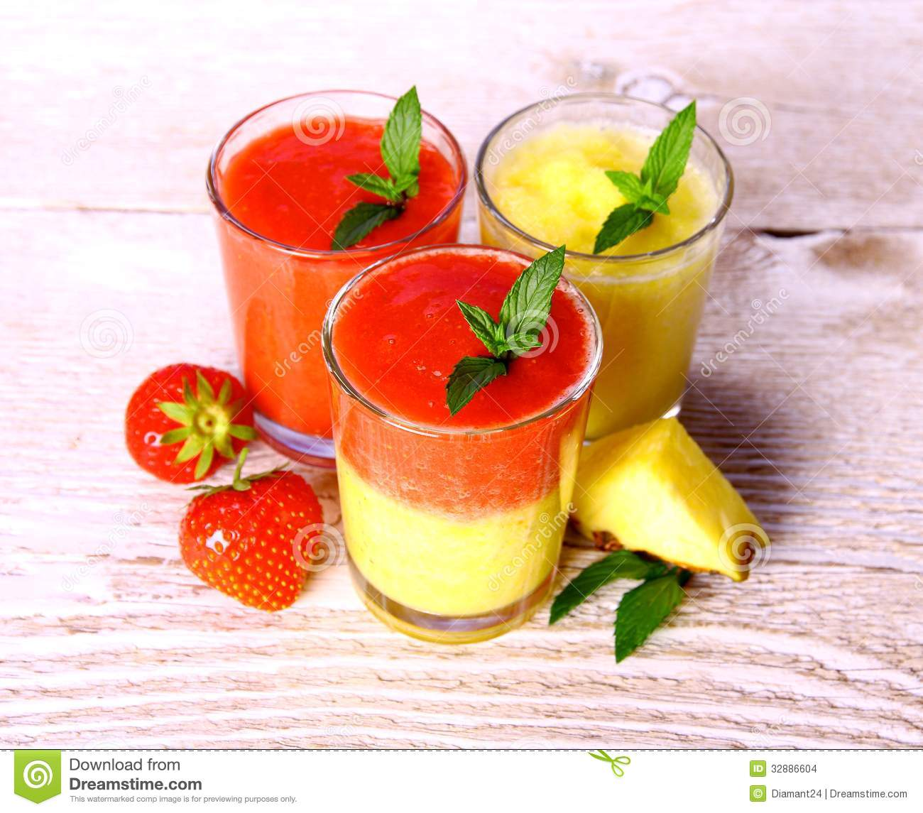 ... Images: Strawberry and pineapple smoothie in glass with fruits, mint