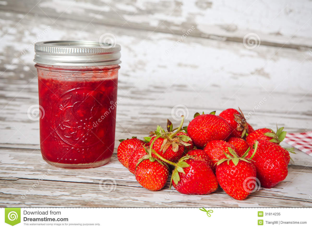 Homemade strawberry preserves and strawberries.