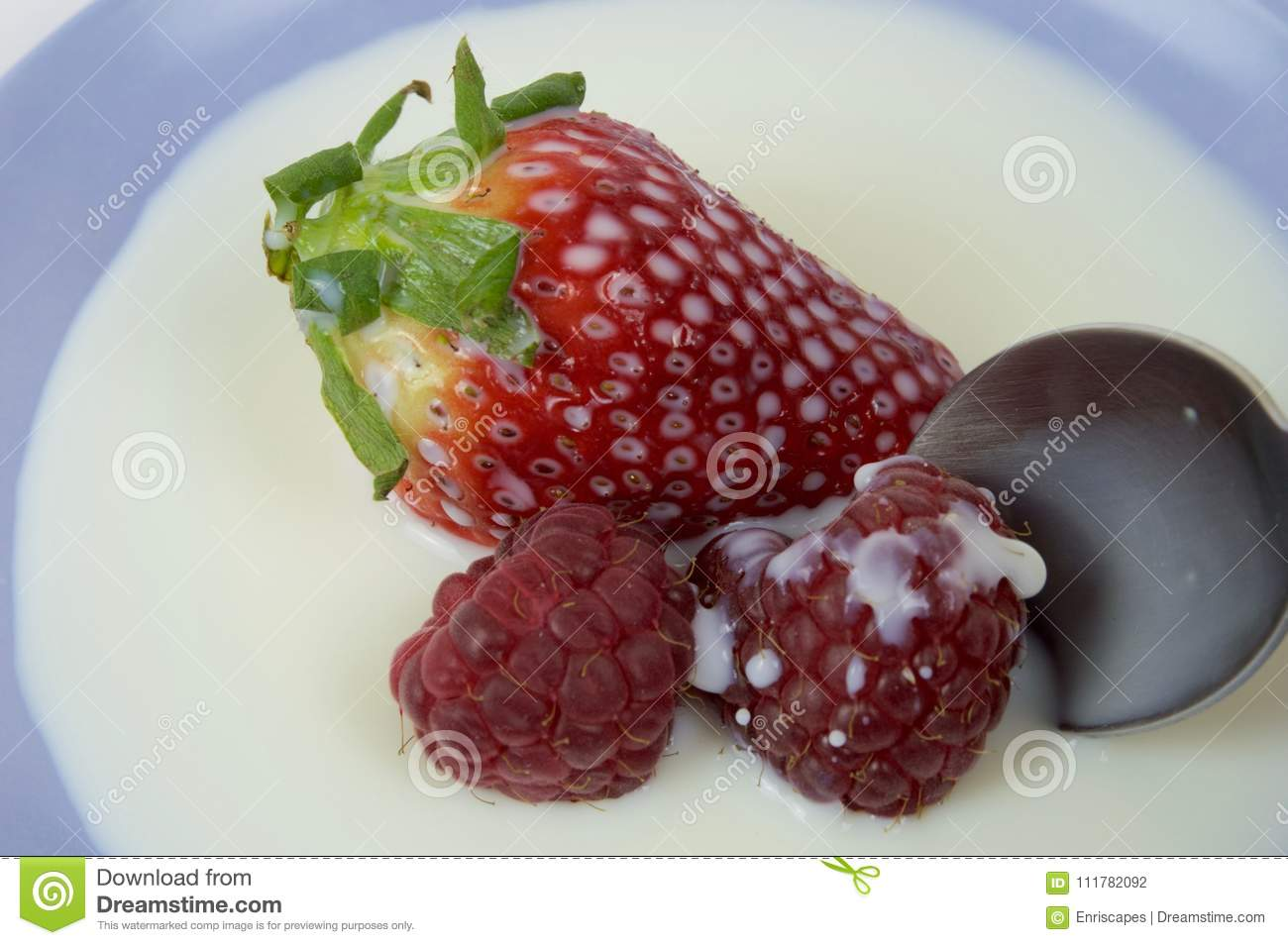 Strawberry and raspberry bathed in milk