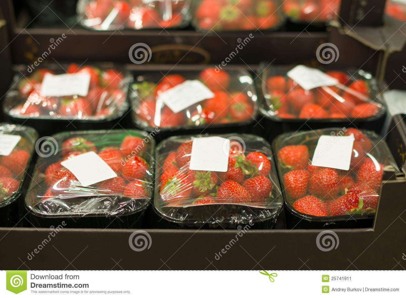 Strawberry in small boxes in supermarket