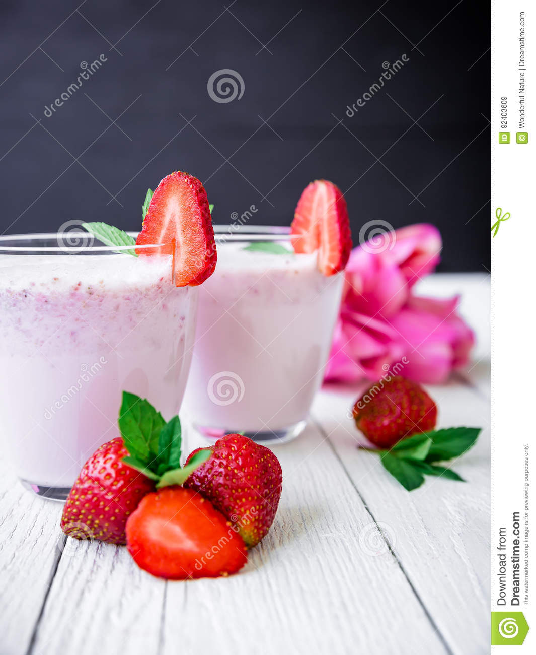 Strawberry smoothie with berries and pink flowers on white wood download strawberry smoothie with berries and pink flowers on white wood table and dark background mightylinksfo