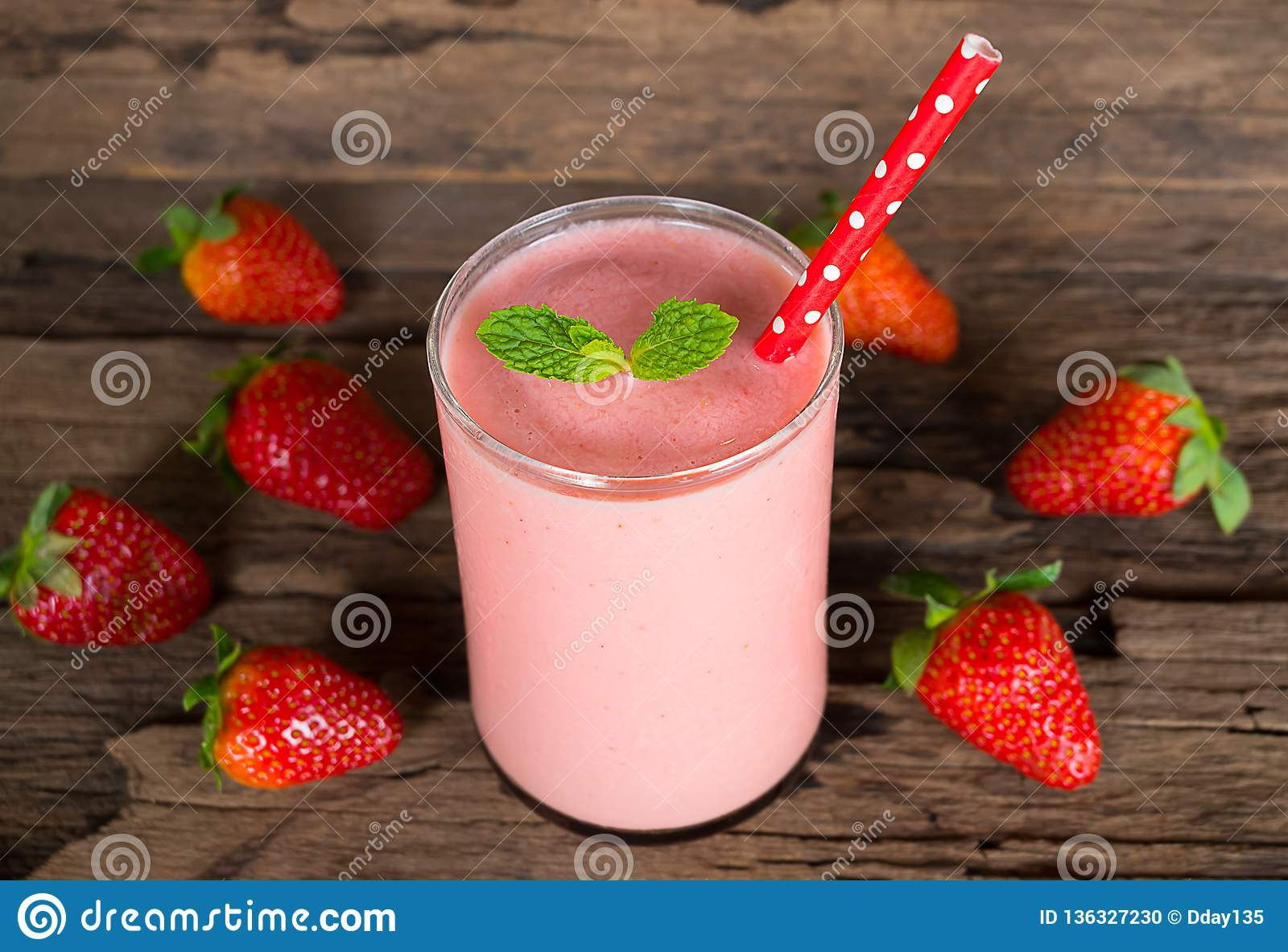 Strawberry smoothies colorful fruit juice beverage healthy the taste yummy In glass drink episode morning on wooden background.