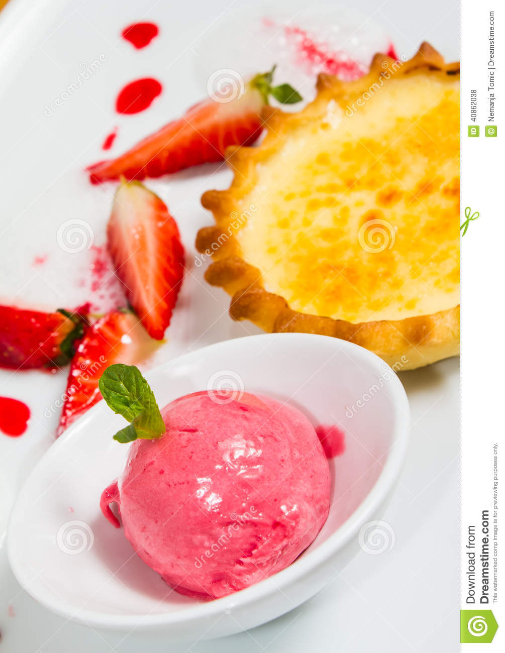Ice cream and vanilla pudding tart with fresh strawberries and foam on ...