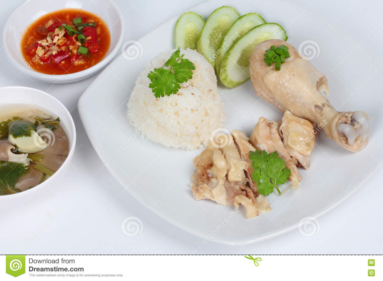 Streamed Oily Rice And Streamed Chicken As Hainanese Chicken Rice S With Spicy Soy Bean Sauce On White Background