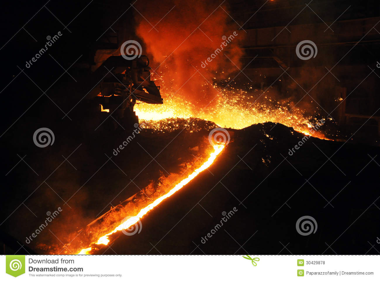 streams of molten iron in a blast furnace the photo was made ??in steel plant located ukraine