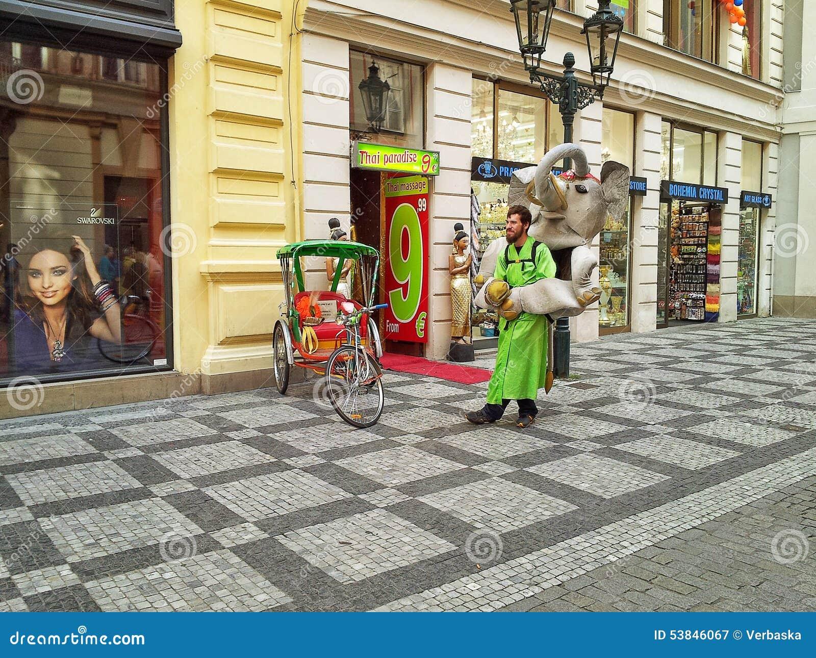 Street advertising man in elephant doll mask editorial for Designhotel elephant prague 1 czech republic