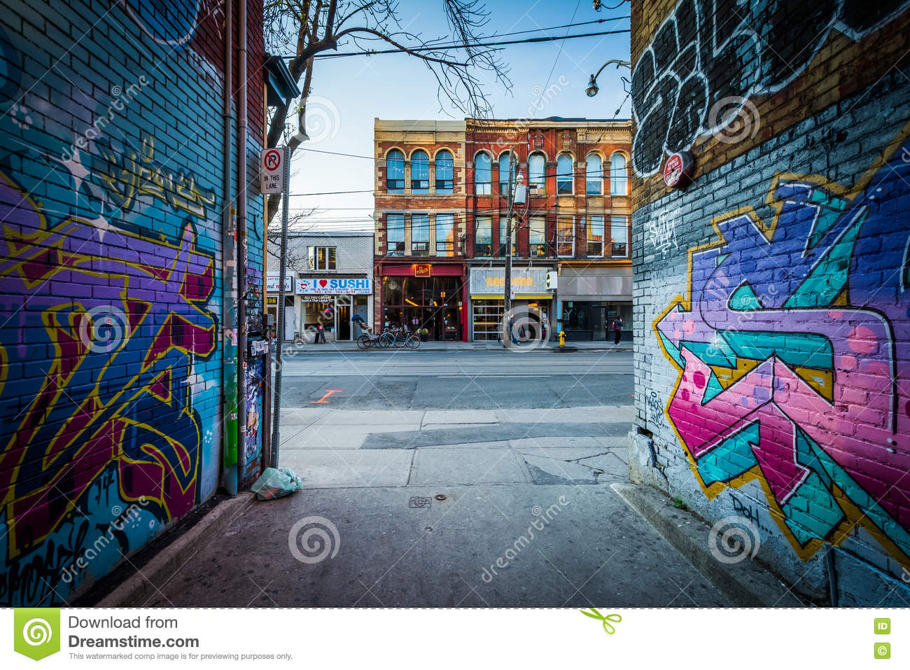 Street art in graffiti alley and buildings on queen street west in the fashion district