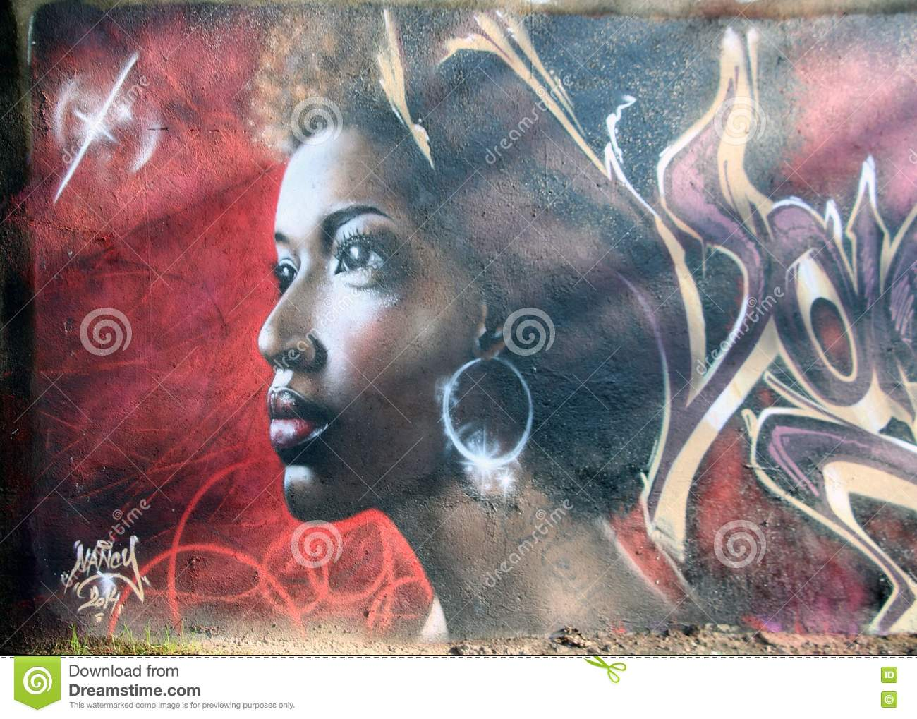 A paint from street artists under the bridge in france city name nancy black beautiful woman