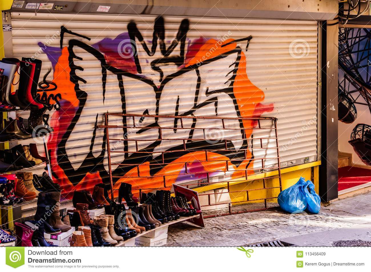 Graffiti Art On A Stores Pull Down Shutter In The Streets Of Istanbul In One Of The Central And Most Crowded Regions Of City Named Kadikoy District