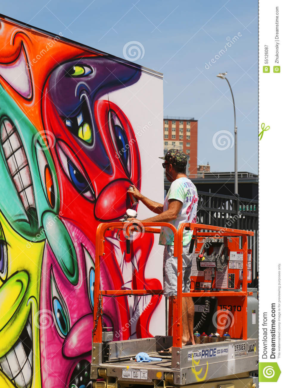 Street artist painting mural at new street art attraction for Coney island mural