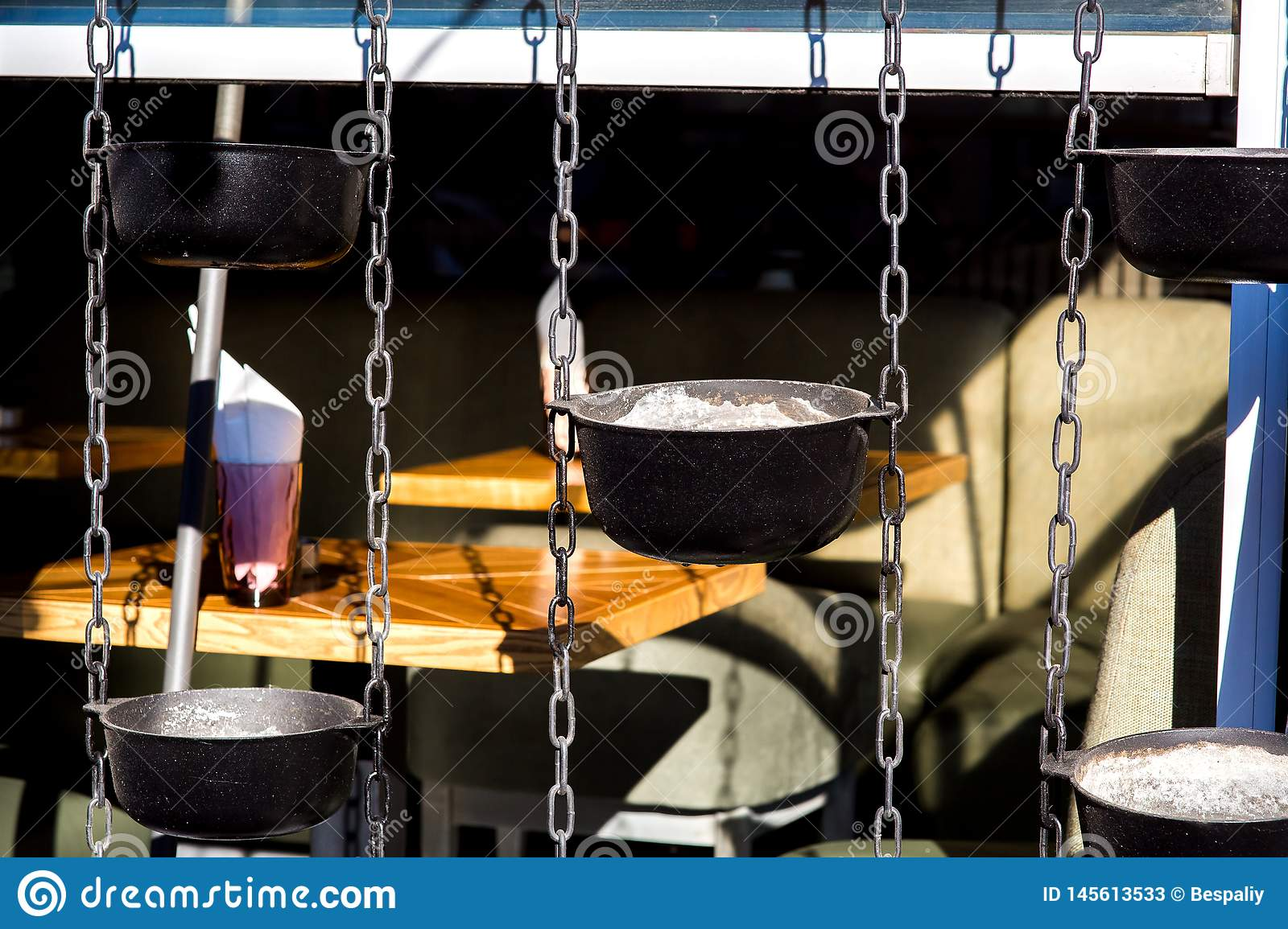 Street Cafe With The Decor Of Hanging Cauldrons On Chains Stock Image Image Of Cauldrons Hanging 145613533