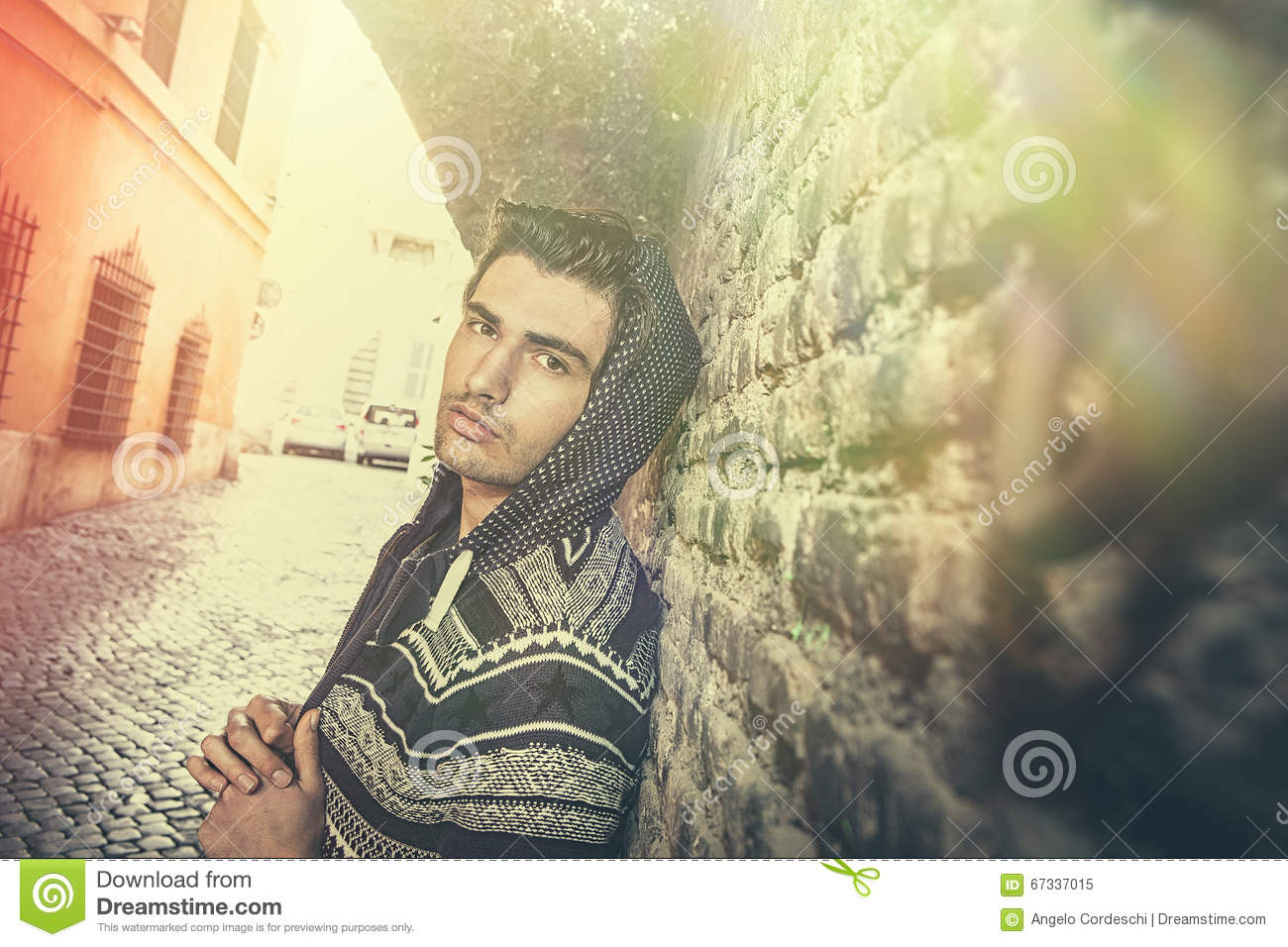 Street city young man model looking, old urban wall