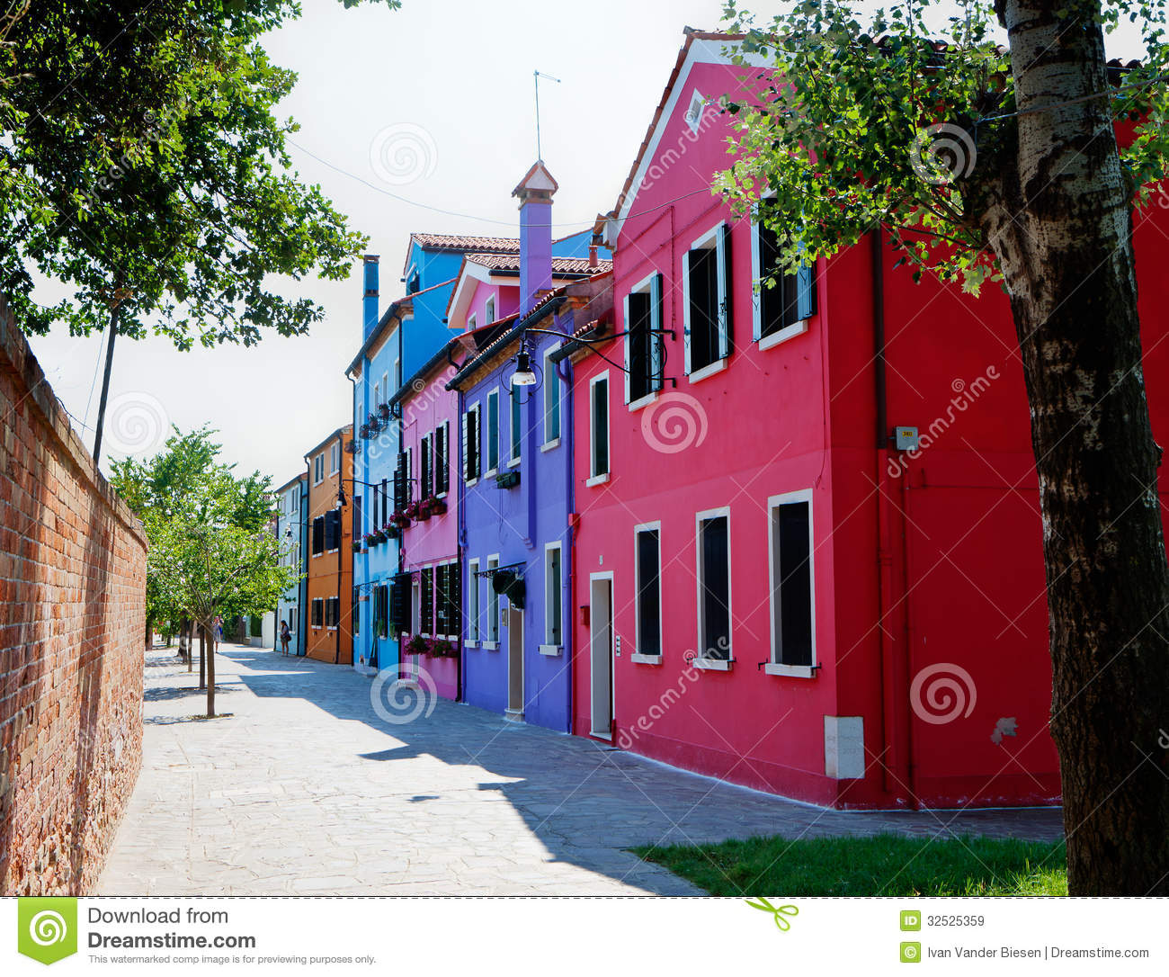 Street with colorful houses in Burano, Italy