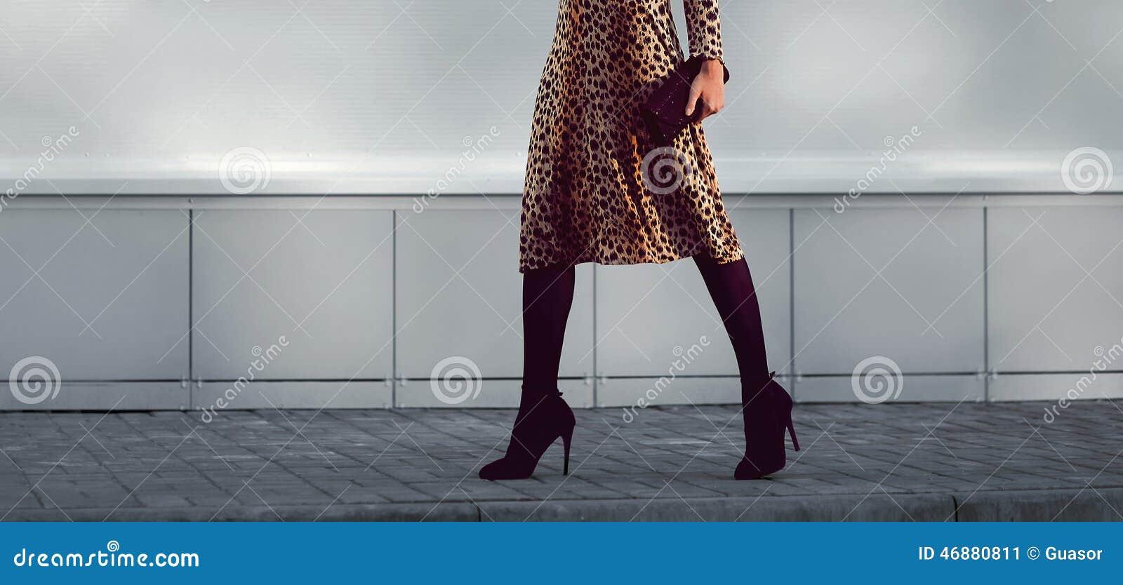 Street fashion concept - stylish elegant woman in leopard dress