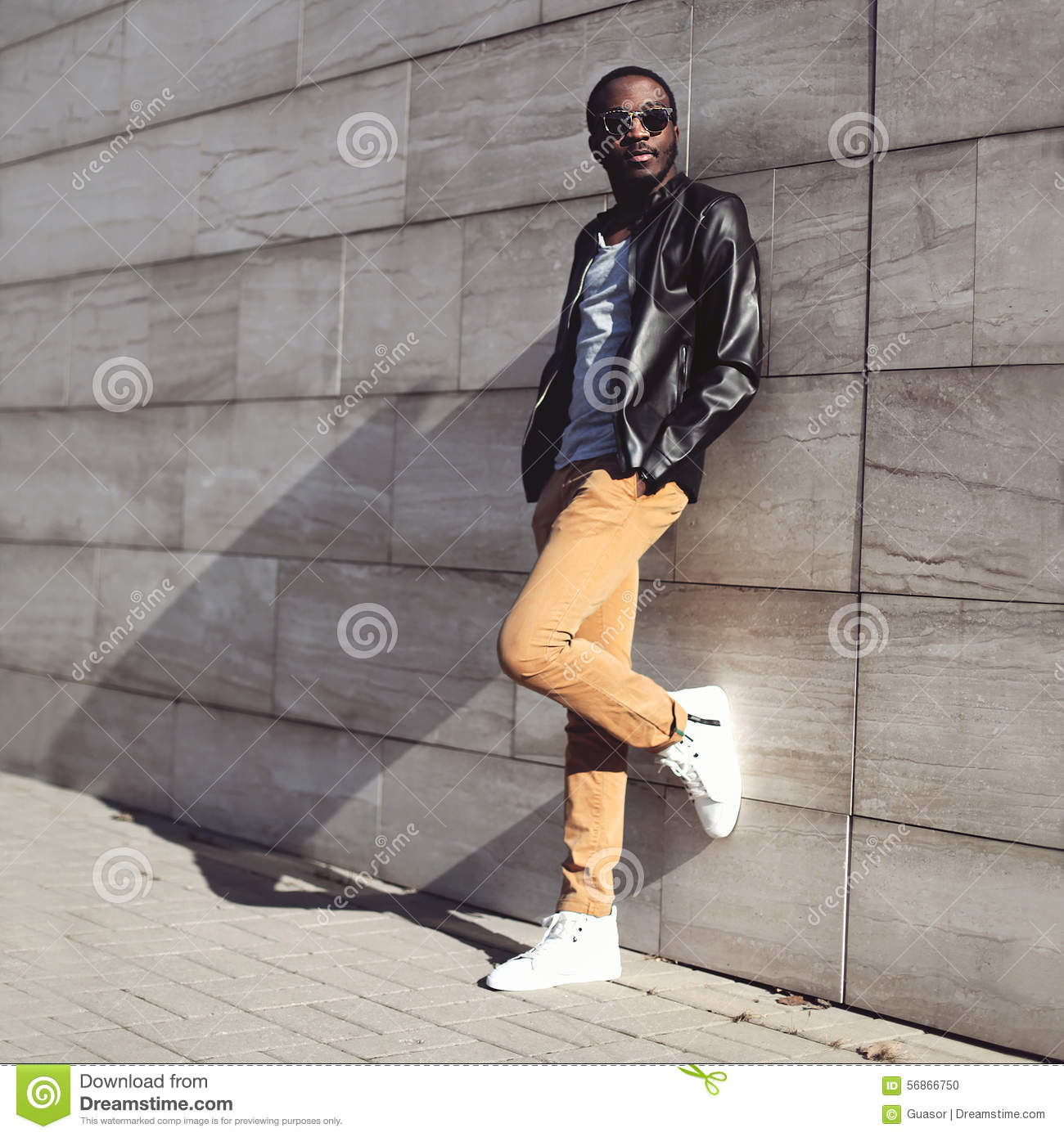 Street fashion, stylish young african man wearing a sunglasses