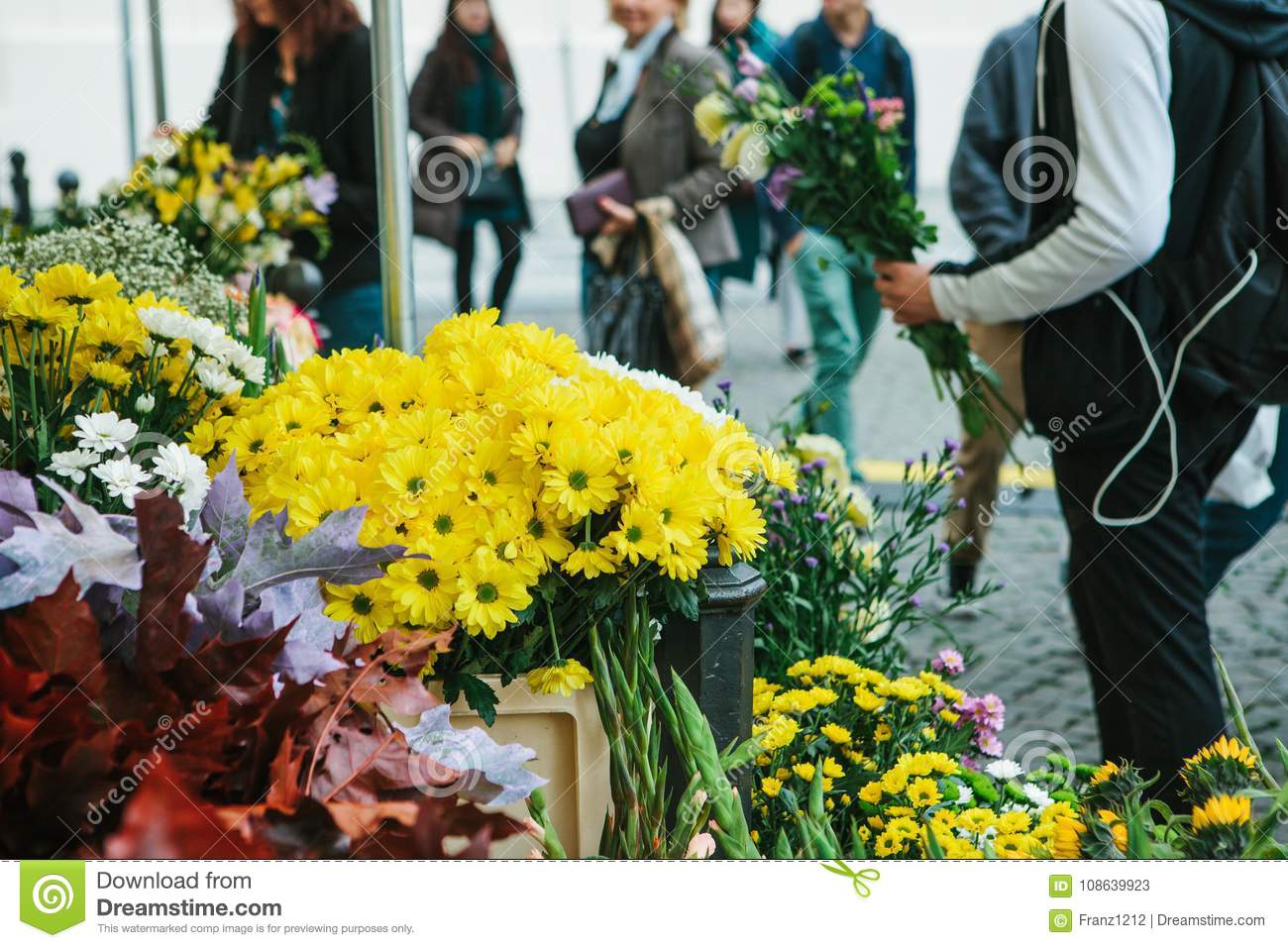 Street flower shop in the foreground there are beautiful yellow and royalty free stock photo izmirmasajfo