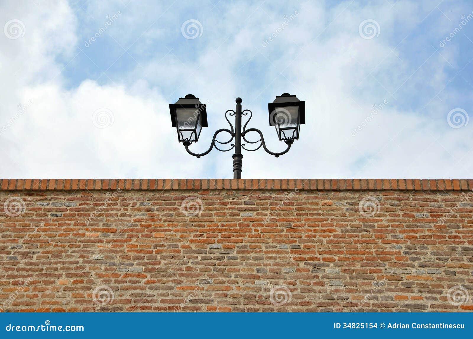 Street Lamp Over Brick Wall Stock Photo