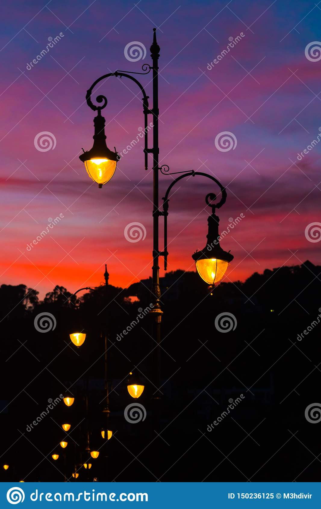 Street lamps with beautiful and colorful sunset sky