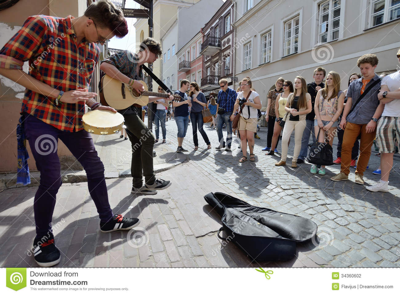 Unidentified musician play guitar in street music day on may 18 2013