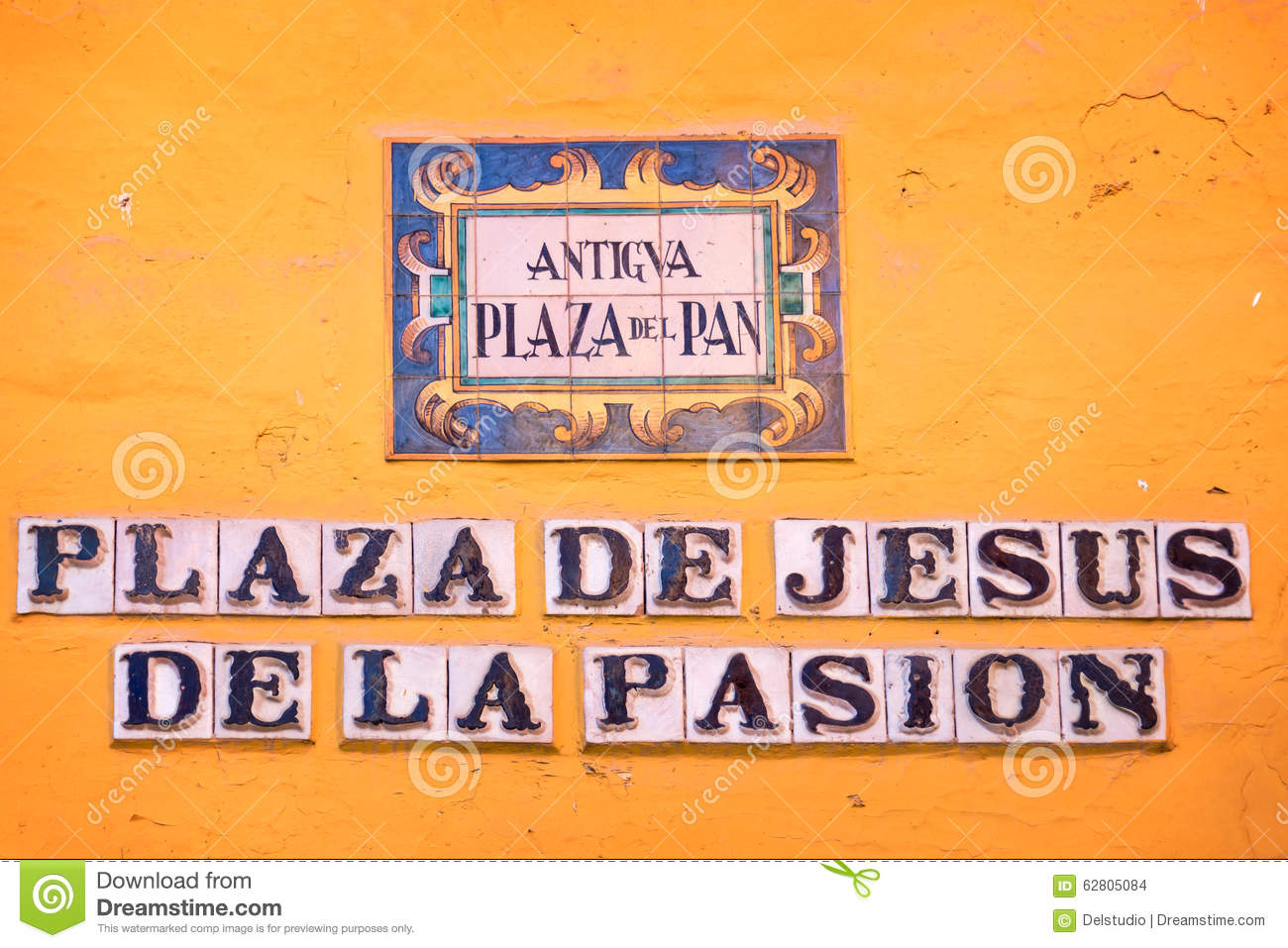 Street name on ceramic tiles in seville stock photo image 62805084 street name on ceramic tiles in seville dailygadgetfo Gallery