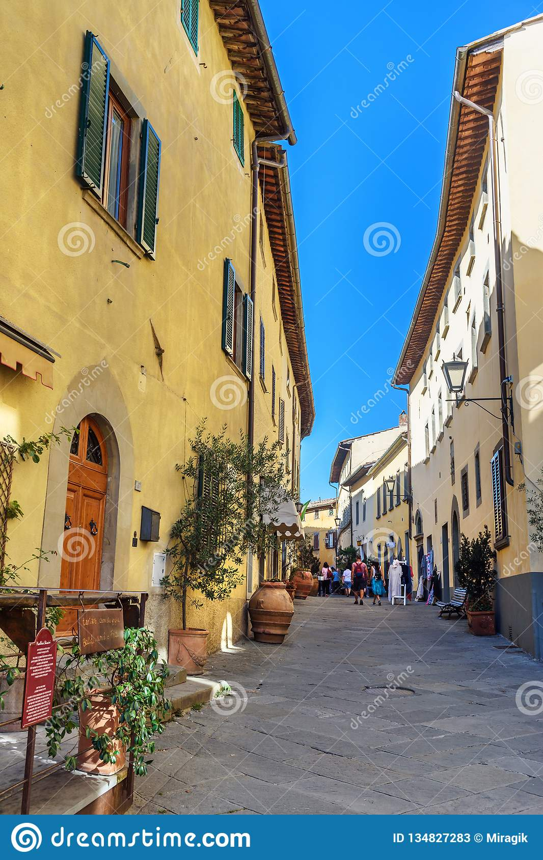 On the street in old medieval village Castellina in Chianti. Tuscany. Italy