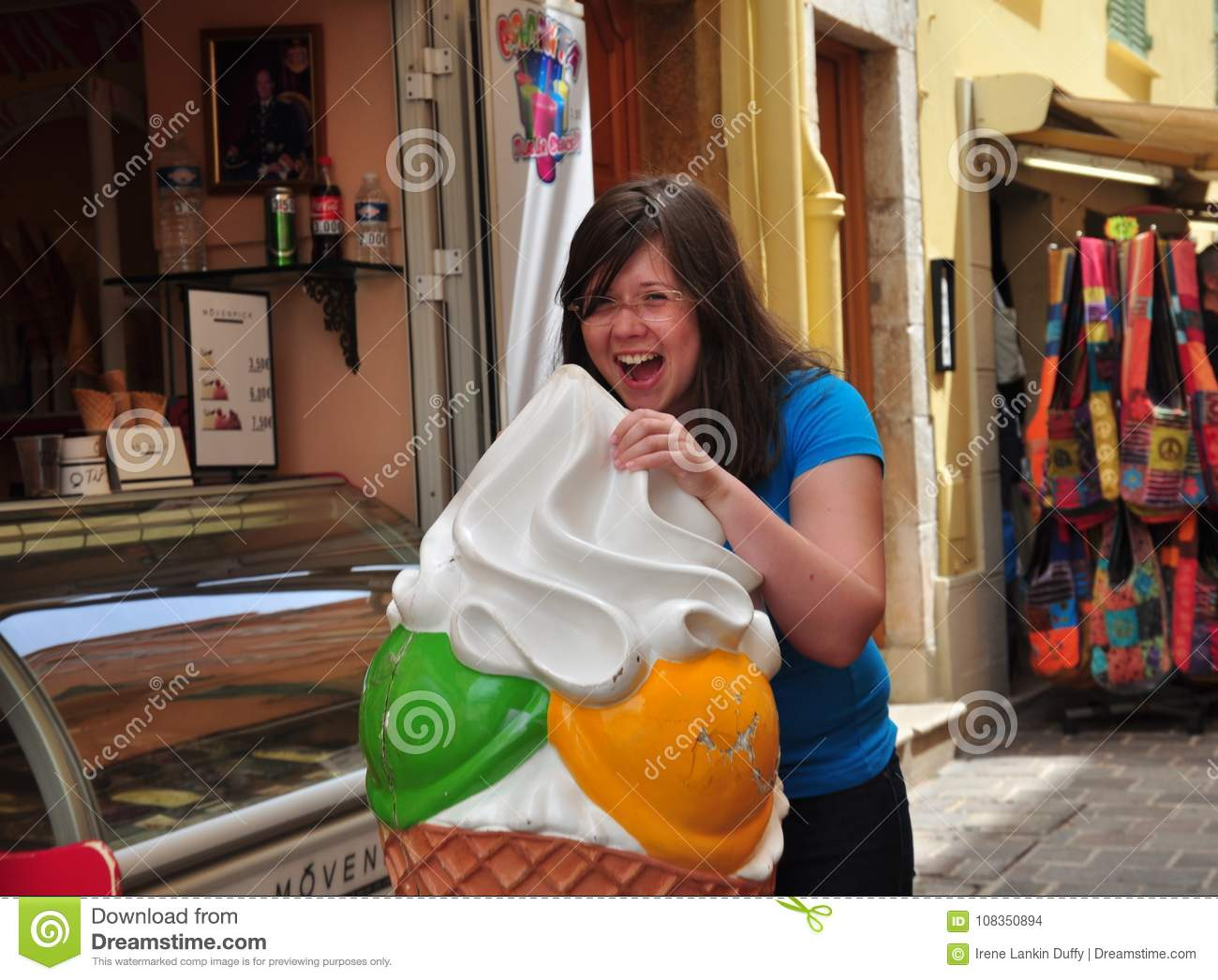 Download Street Portrait Of A Girl Eating Ice Cream Stock Photo - Image of unique, girl: 108350894