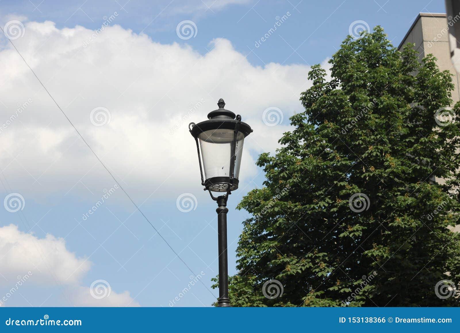 Street retro lamp against the blue sky