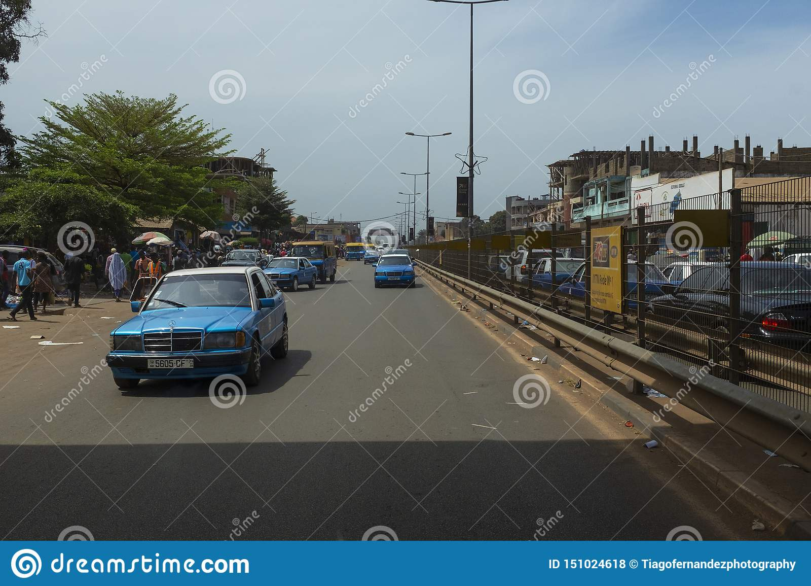 Street scene in the city of Bissau with cars in an avenue near the Bandim Market, in Guinea-Bissau
