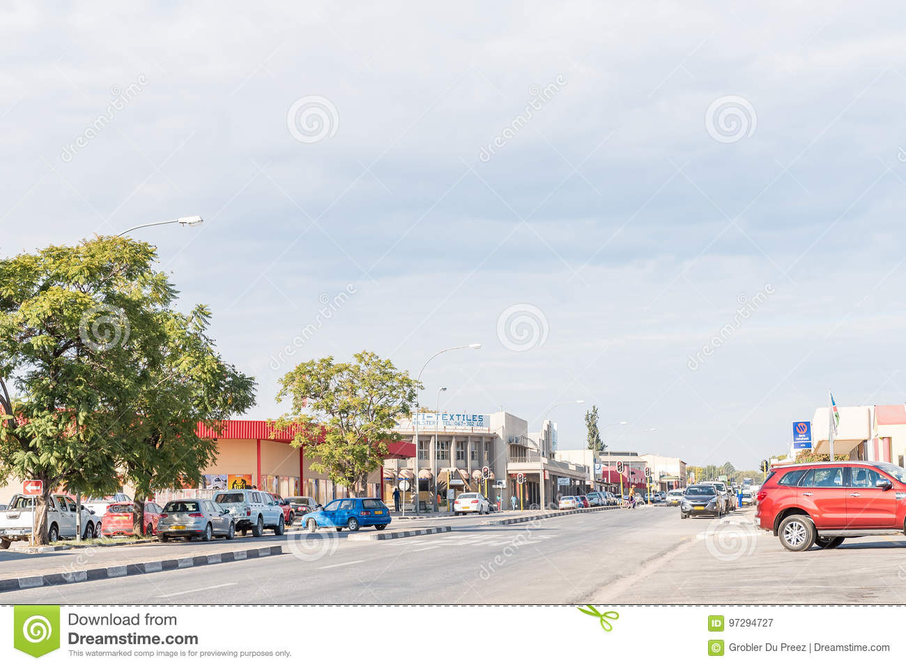 Street scene with several businesses and vehicles in Otjiwarongo