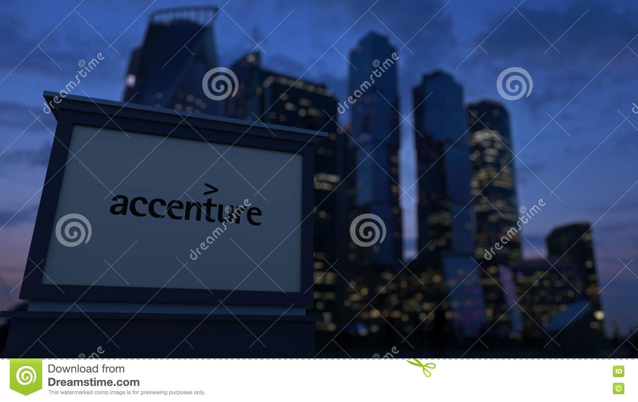 Street Signage Board With Accenture Logo In The Evening  Blurred