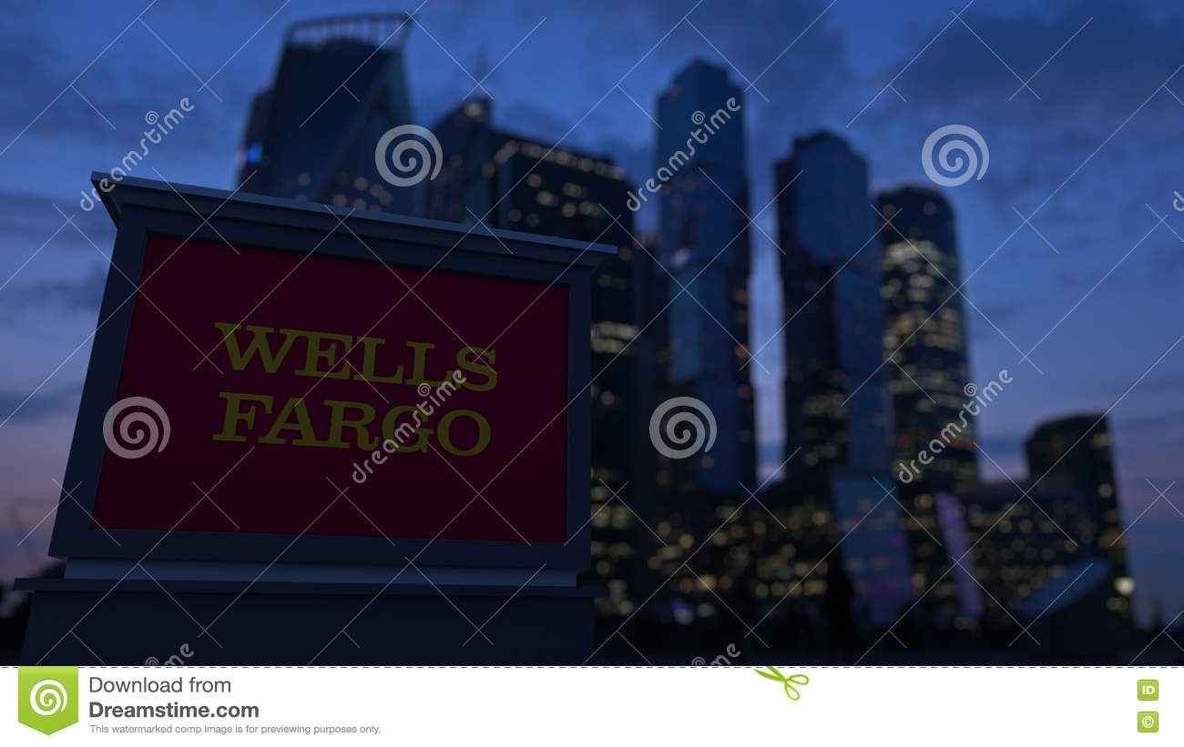Street signage board with Wells Fargo logo in the evening. Blurred business district skyscrapers background. Editorial