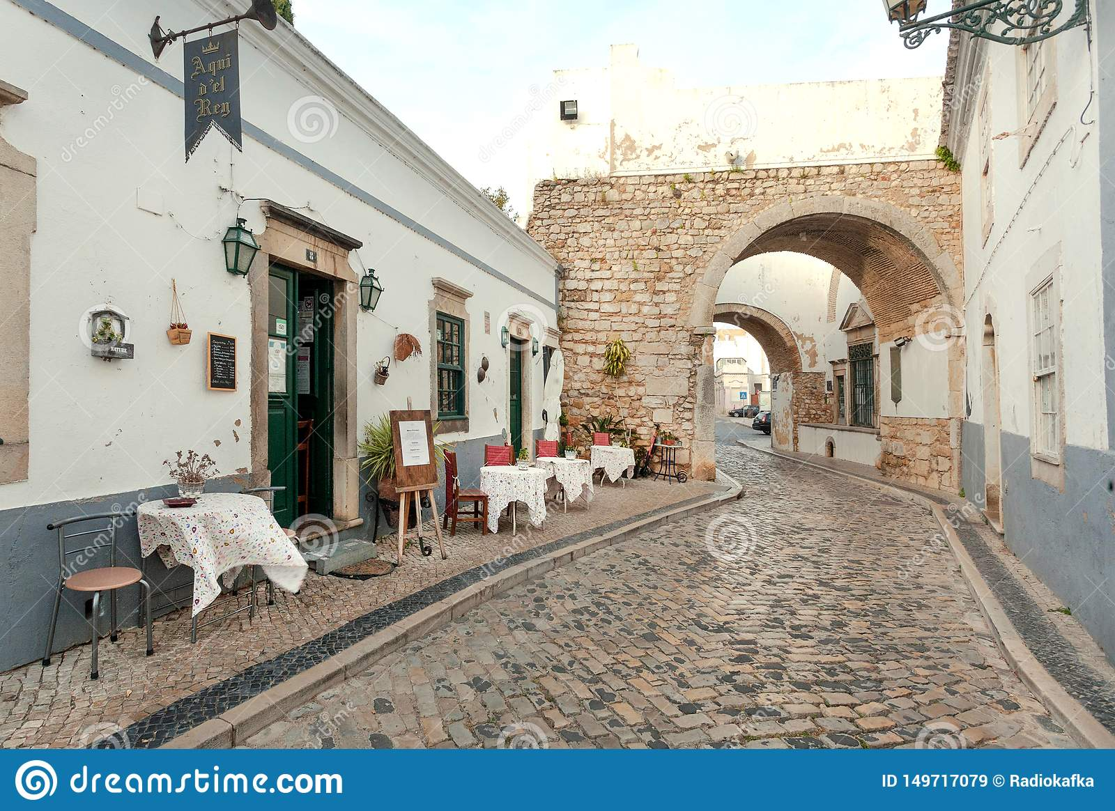 Street With Small Restaurant With Tables For Drinking And