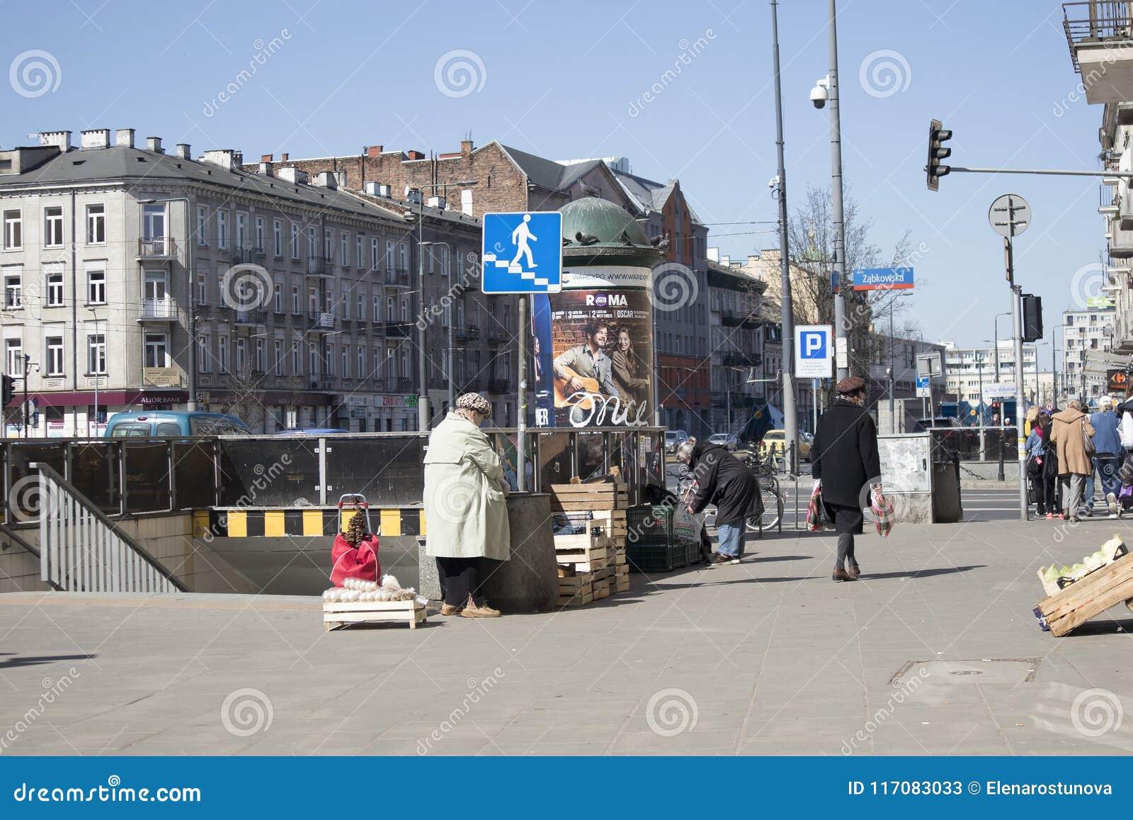Street Vendors Sell Fruit Near The Underground Passage In