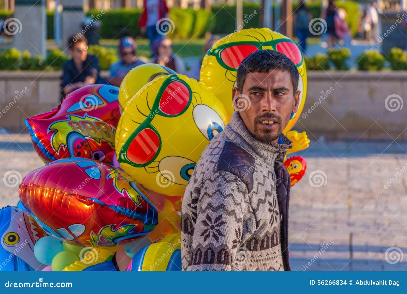 Street vendors selling balloons