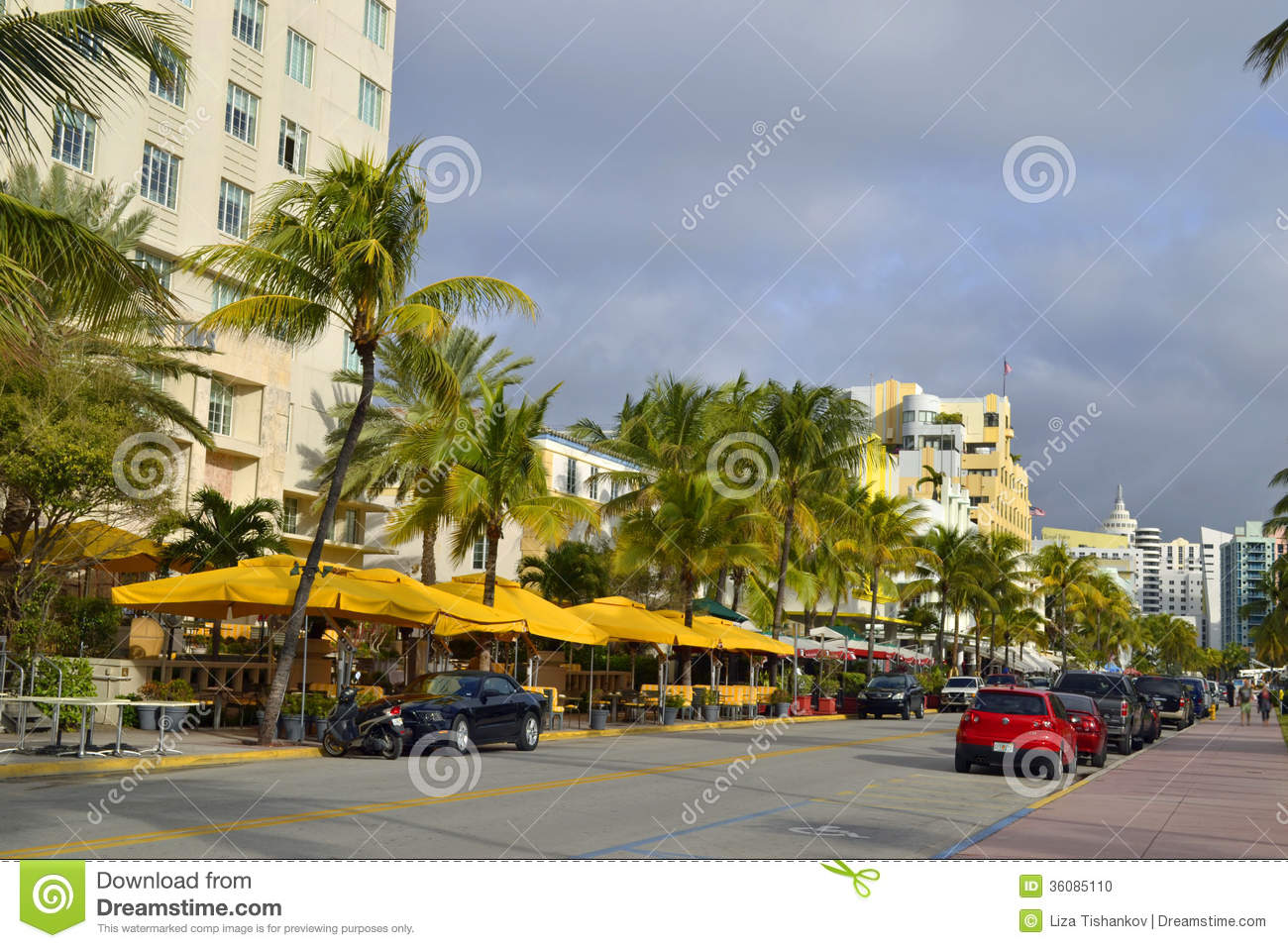 Tourists And Luxury Cars At Ocean Drive In Miami Beach