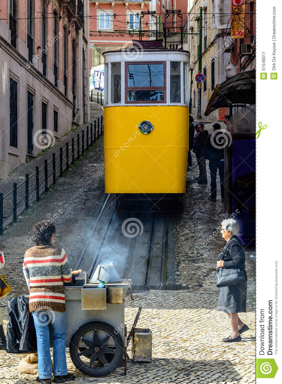Streets in Lisbon, Portugal with yellow tram