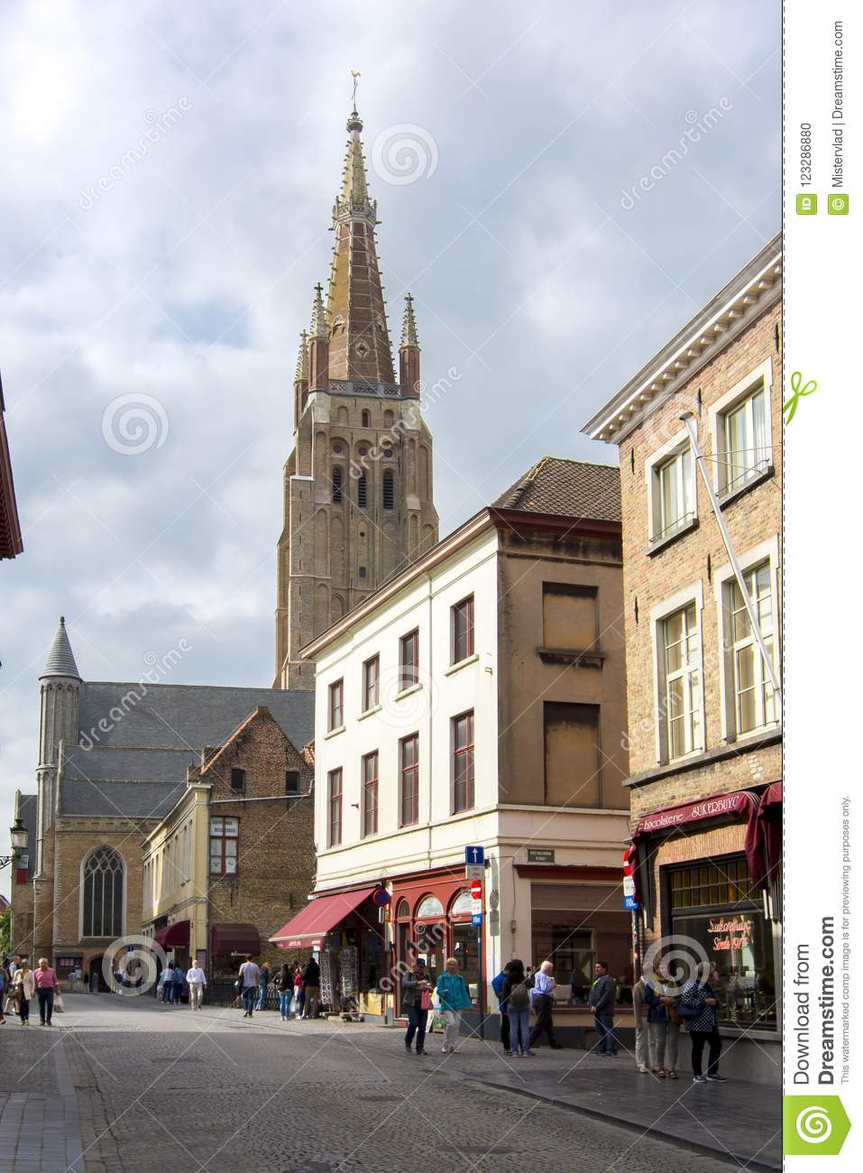 Streets of old Bruges and Church of Our Lady tower, Belgium