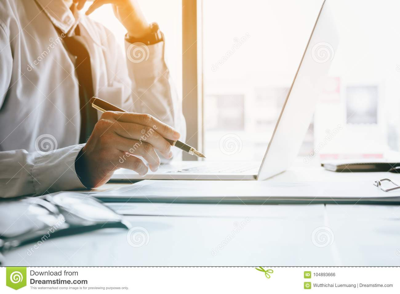 Stress Businessman At Office Room Holding Pen Pointing