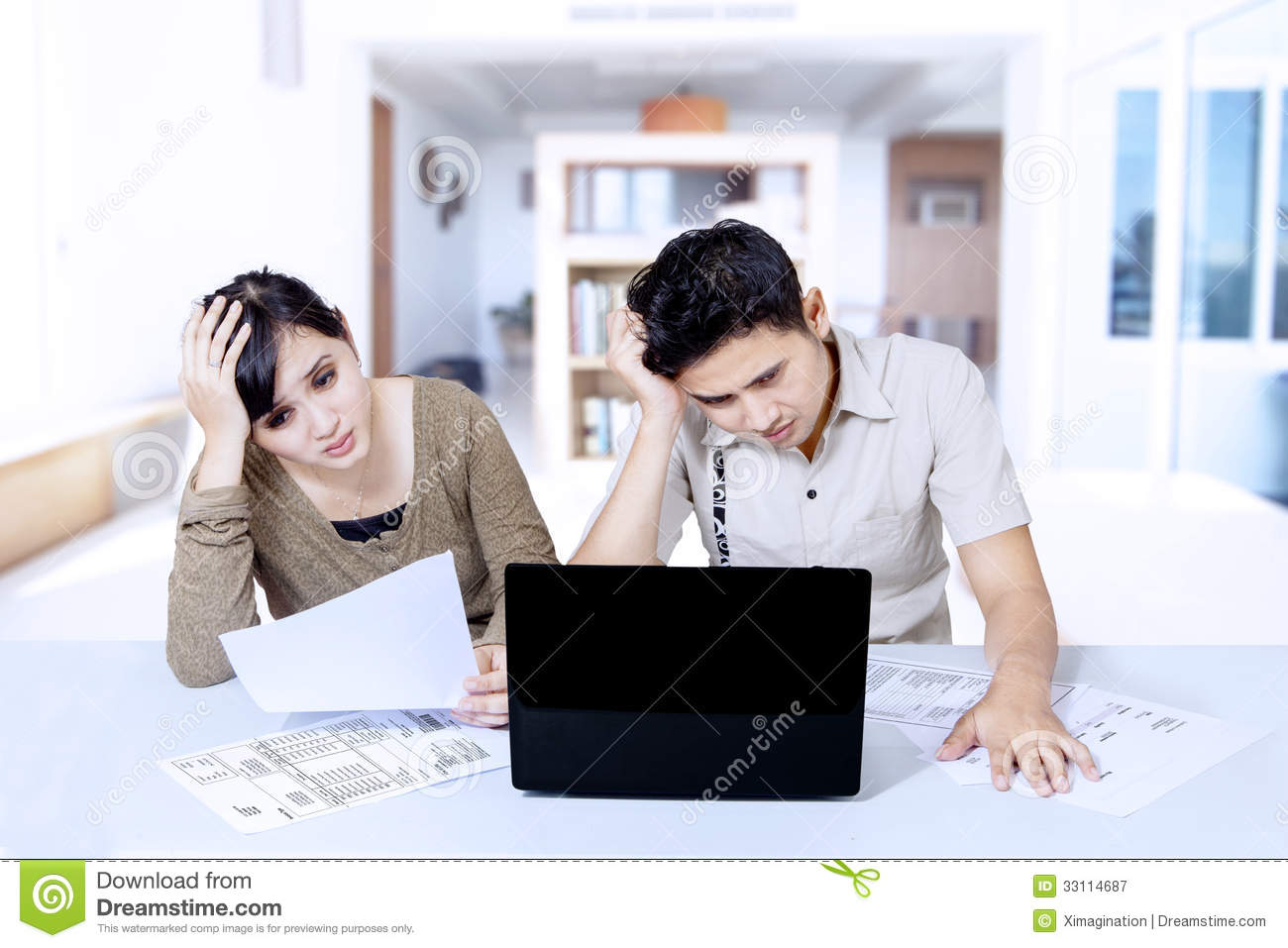 Stress couple paying bill online at home