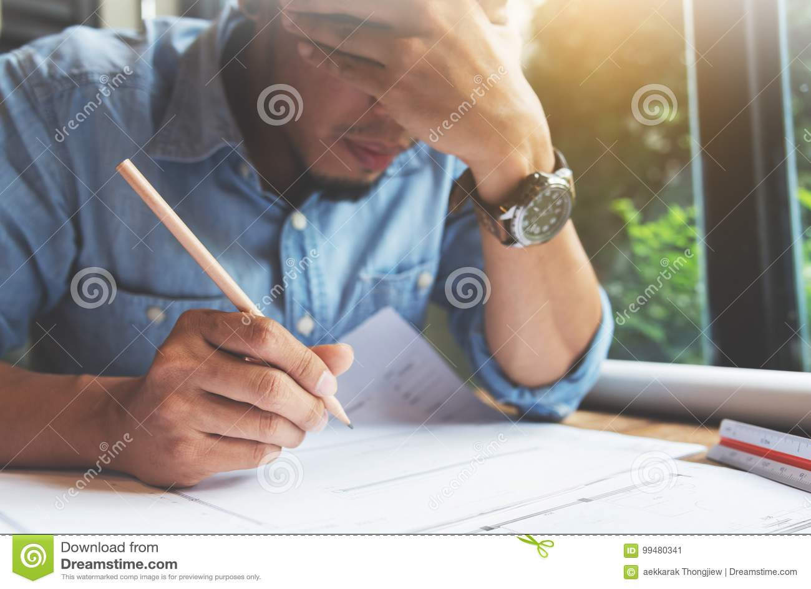 Stressed Asian Freelance designer.