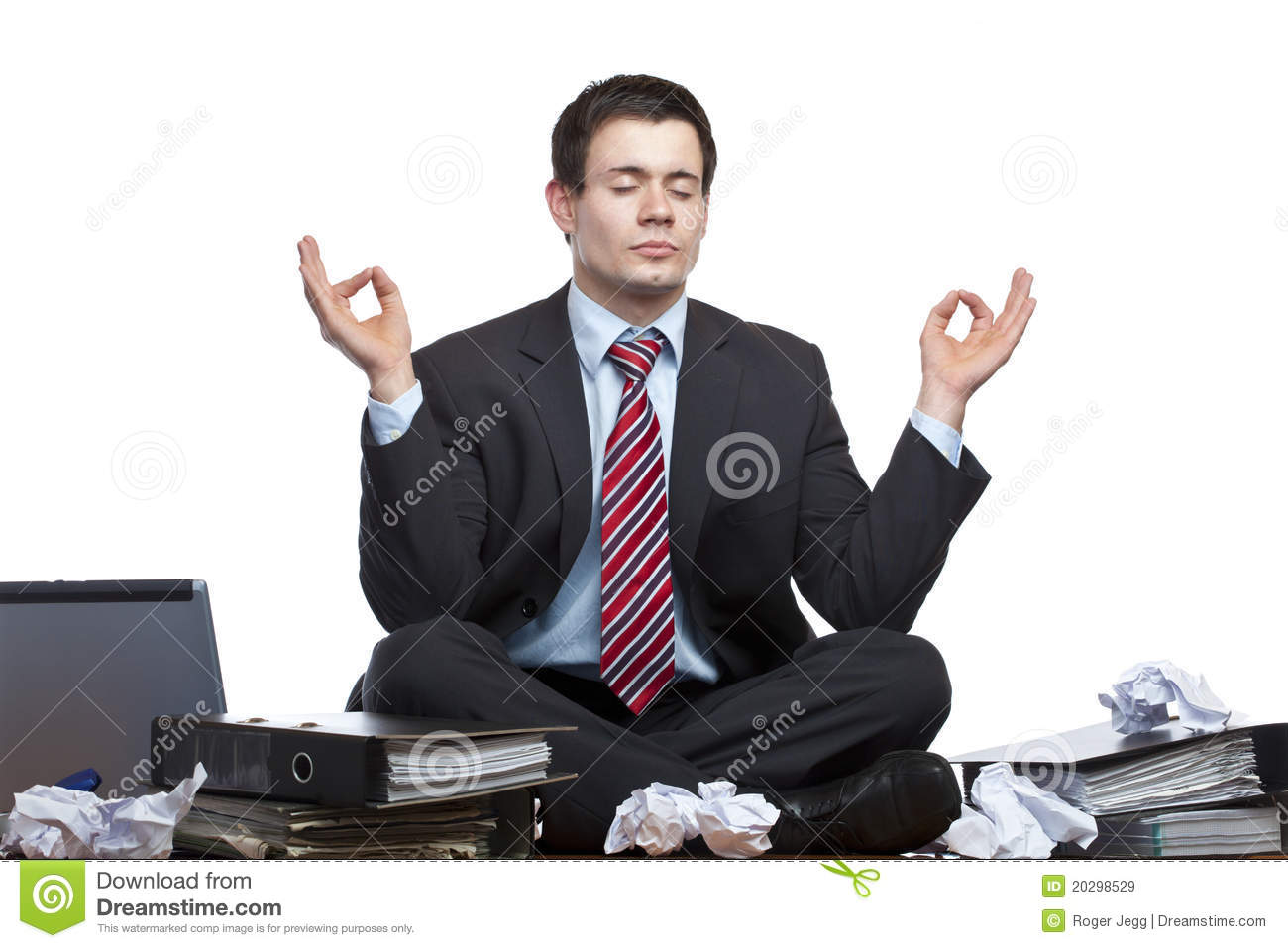 Stressed business man meditates at desk in office